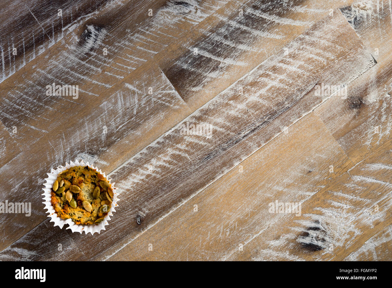 Handmade Savoury Blue Cheese Cupcake on vintage wooden background, aerial top view, toned filter applied, available - Stock Image