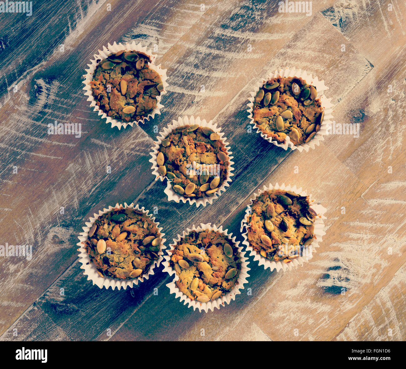 Handmade Savoury Blue Cheese Cupcakes on vintage wooden background, aerial top view, toned filter applied - Stock Image