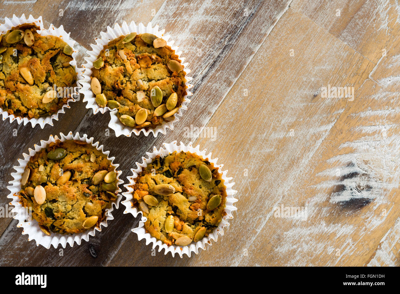 Handmade Savoury Blue Cheese Cupcakes on vintage wooden background, aerial top view, available copy space on the - Stock Image