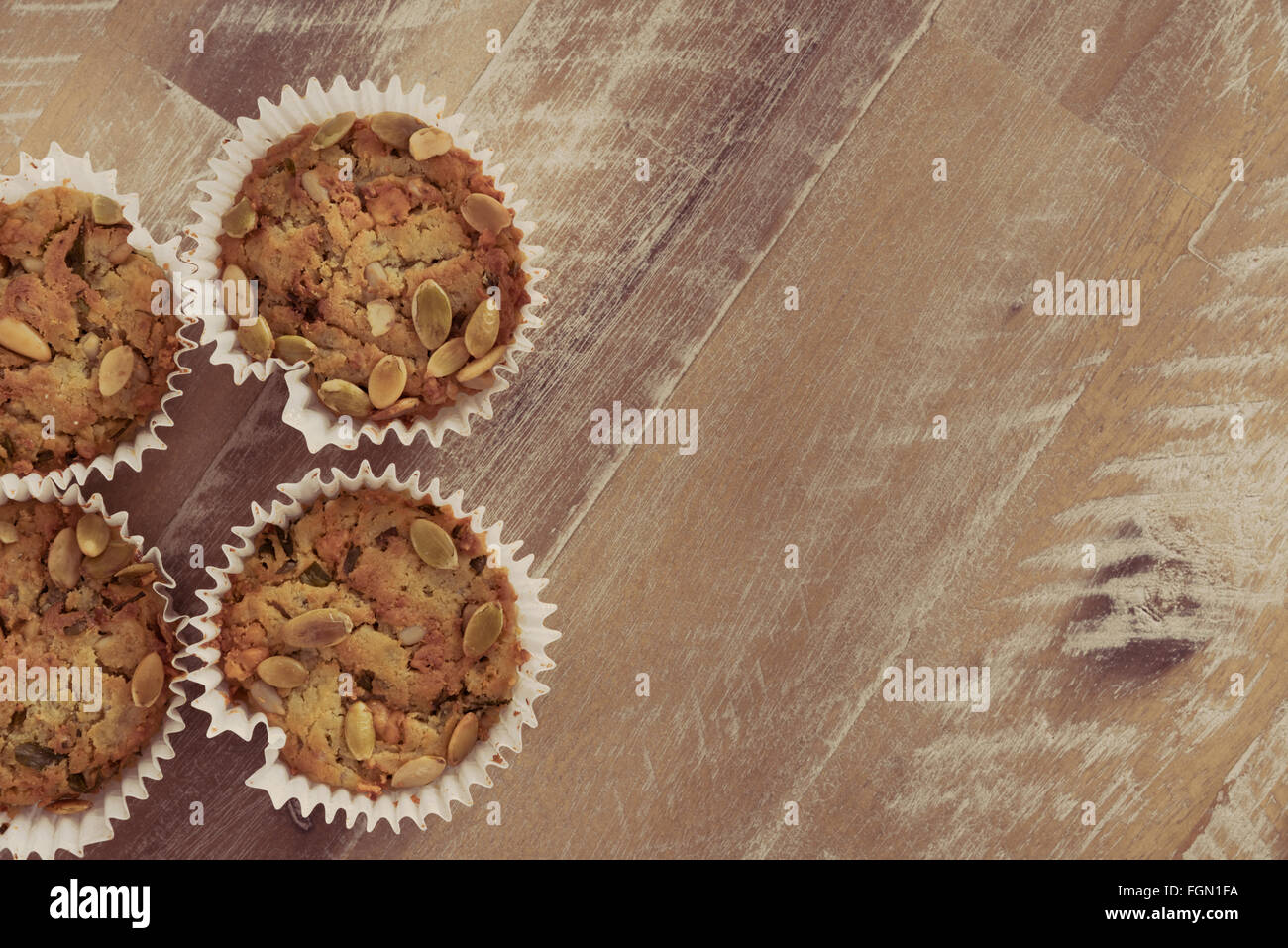 Handmade Savoury Blue Cheese Cupcakes on vintage wooden background, aerial top view, toned filter applied, available - Stock Image