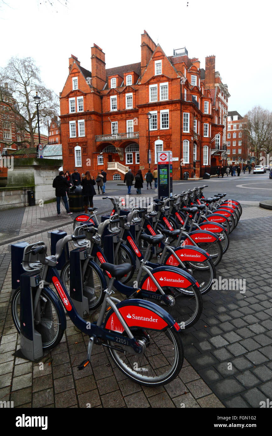Santander Cycles hire bicycles at a docking station in Exhibition Road, Kensington, London, England Stock Photo