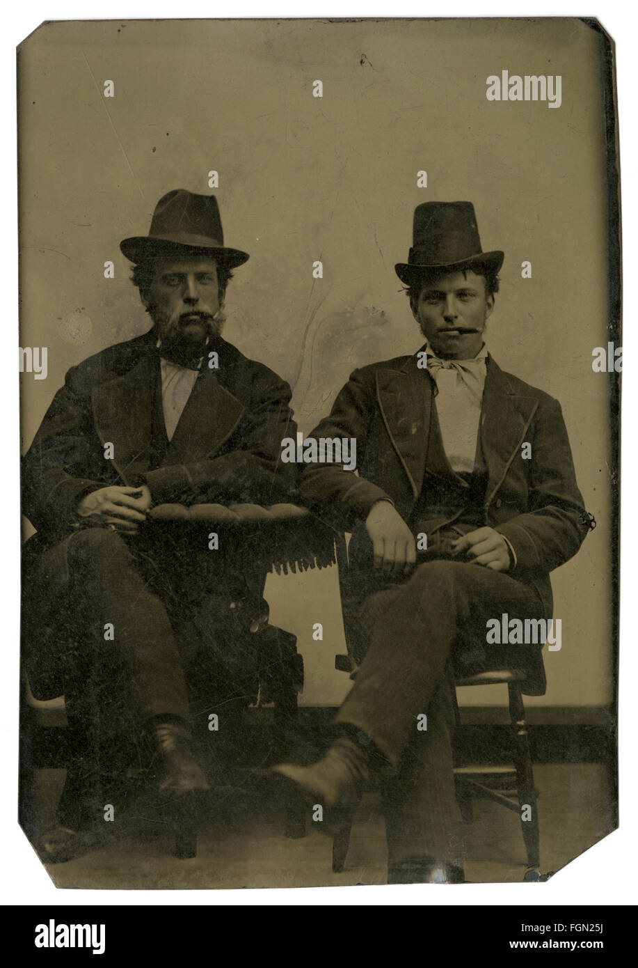 Circa 1860 tintype photograph, two gentlemen, possibly father and son, with cigars. SOURCE: ORIGINAL TINTYPE IMAGE. - Stock Image