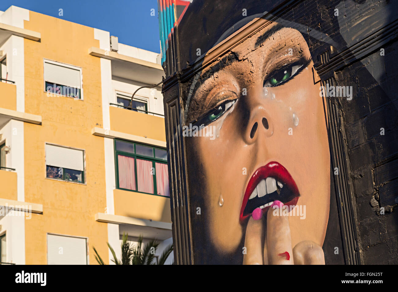 Woman's face painted on old church building, Olhao, Algarve, Portugal - Stock Image