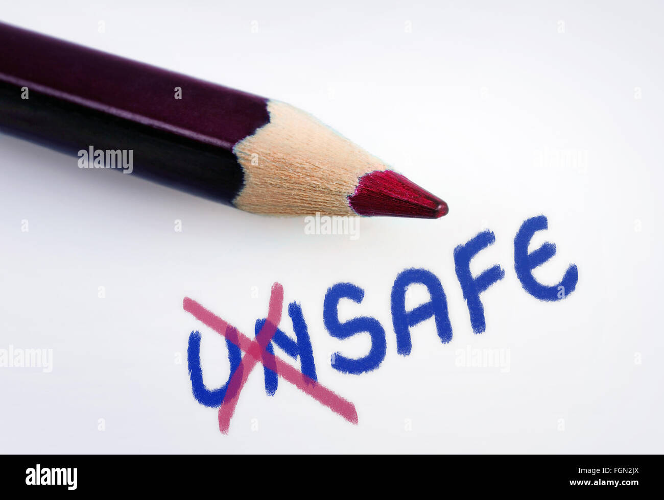 Unsafe word on grey background - Stock Image