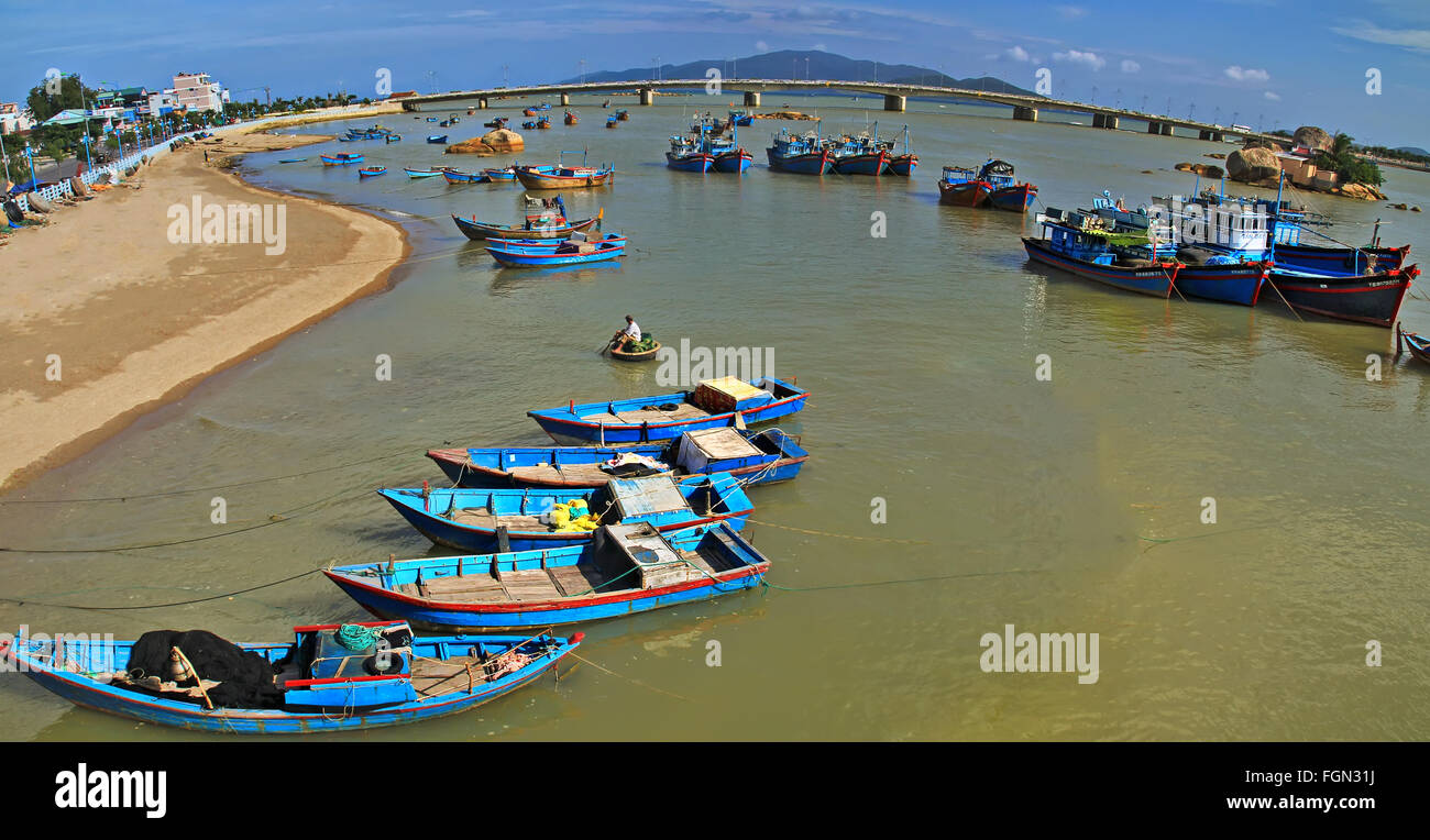 Fishing boats in harbor at Nha Trang, Vietnam. Panoramic view Stock Photo