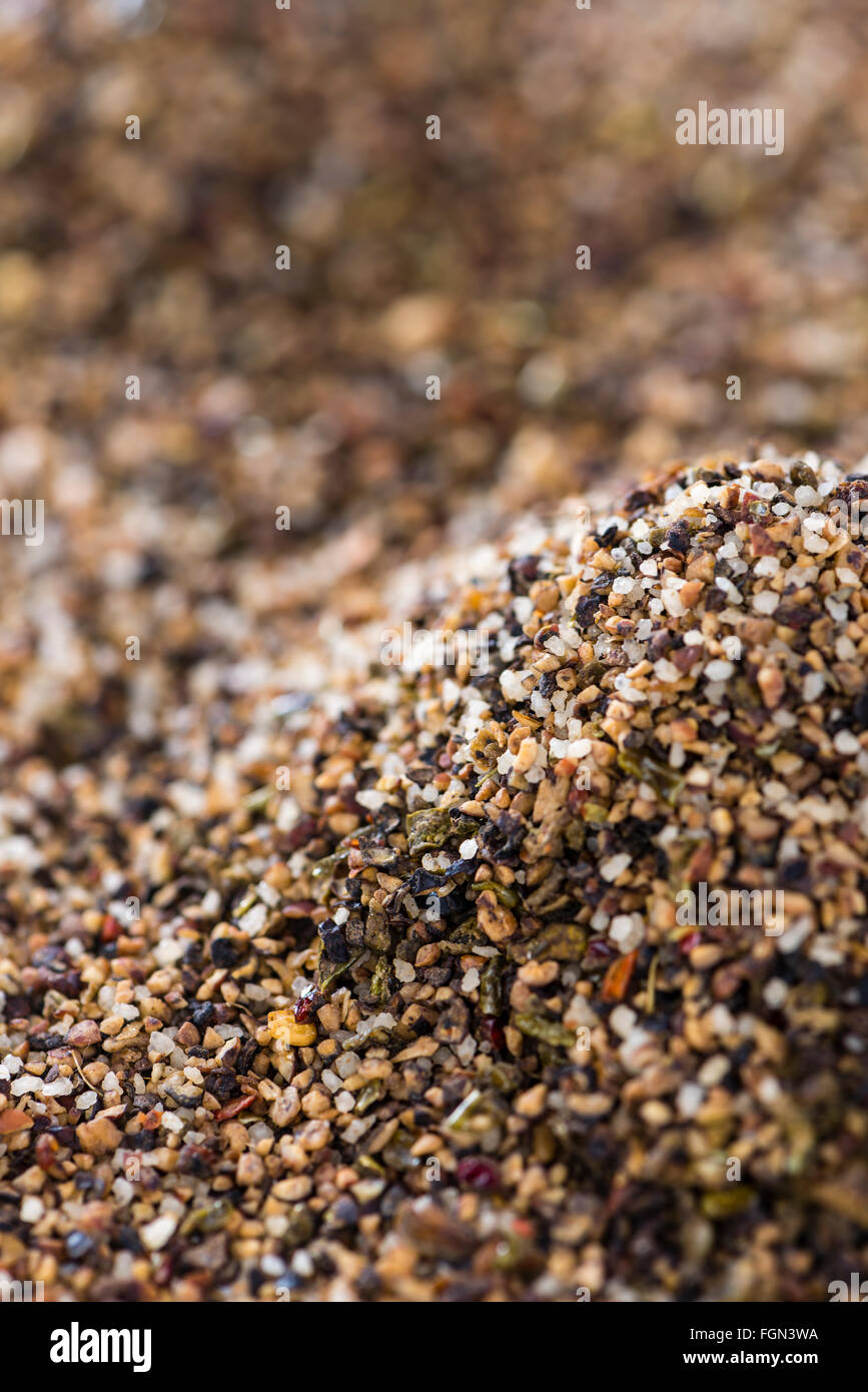 Crushed Peppercorns for use as background image or as texture (detailed close-up shot) - Stock Image