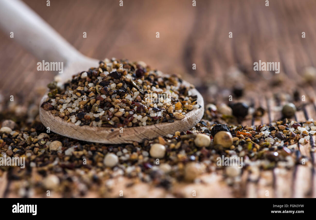 Crushed Peppercorns with different spices and salt (close-up shot) - Stock Image