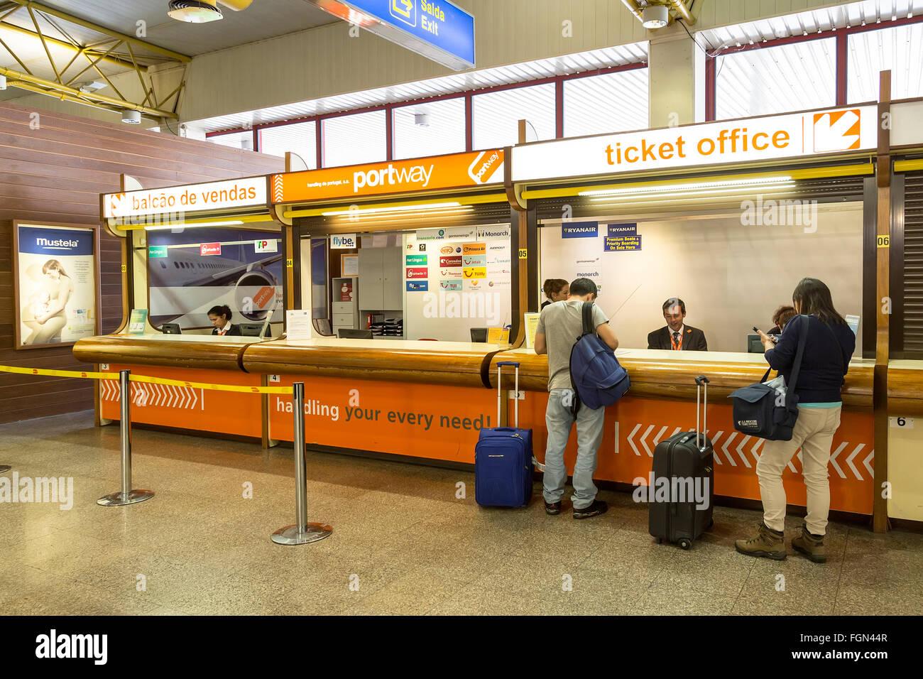 Ryanair desk at Faro airport, Portugal - Stock Image