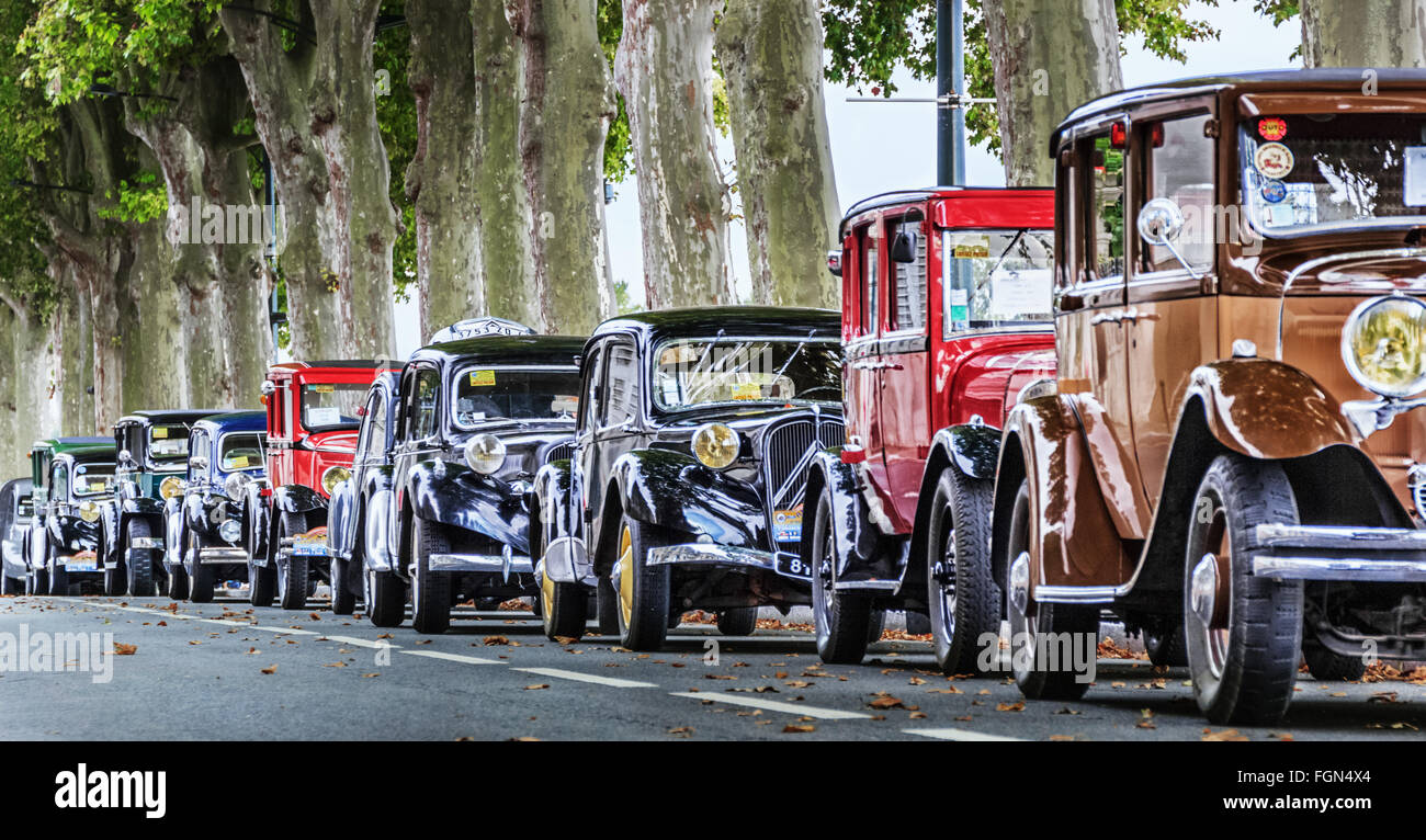 A cavalcade of beautiful oldtimers - Stock Image