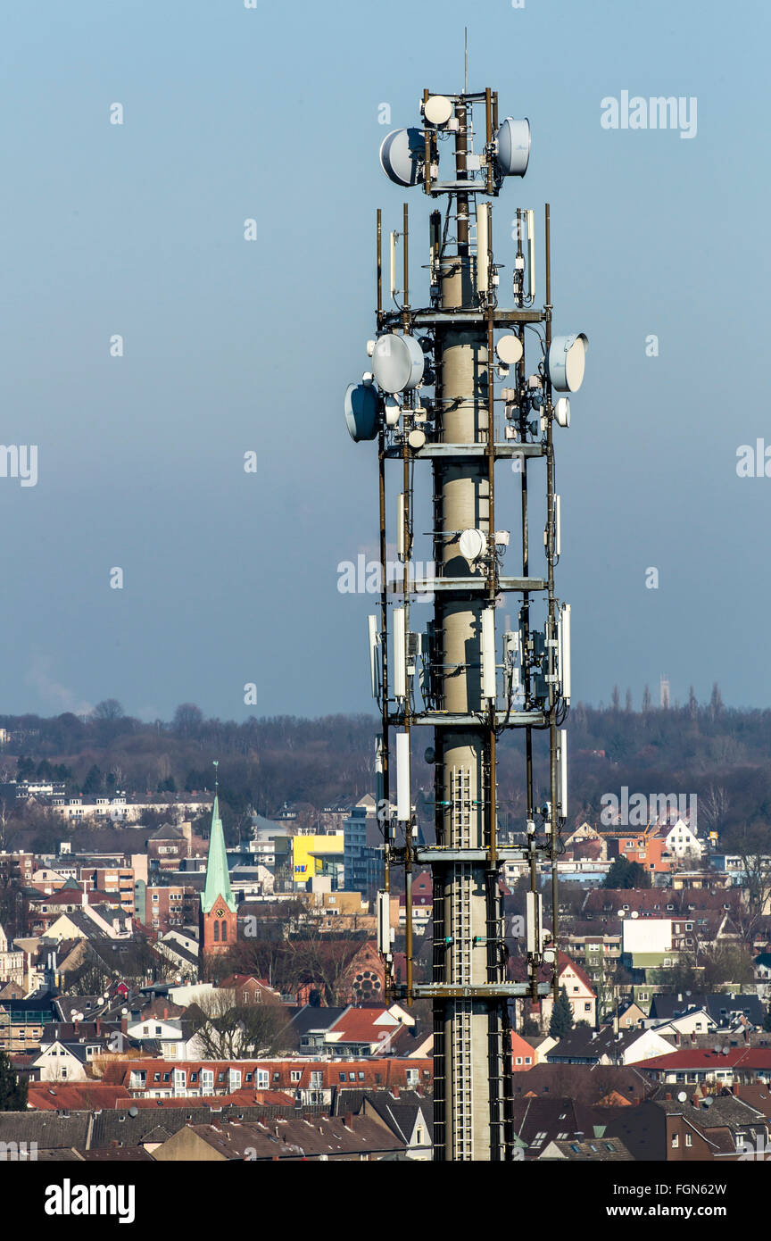 Radio mast antenna mast, with transmitting and receiving systems, Cellular phone reception, city of Herten, Germany, - Stock Image