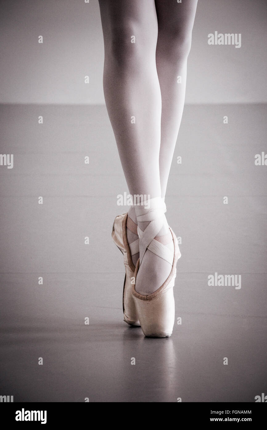 Ballet Dancer Legs Pointe Shoes - Stock Image