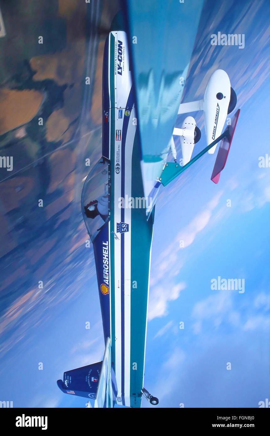 Aerobatic airplane in flight - Stock Image