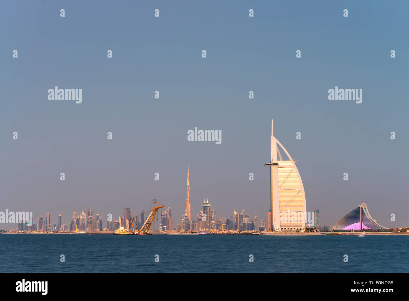Skyline of Dubai waterfront with Burj al Arab Hotel in United Arab Emirates - Stock Image