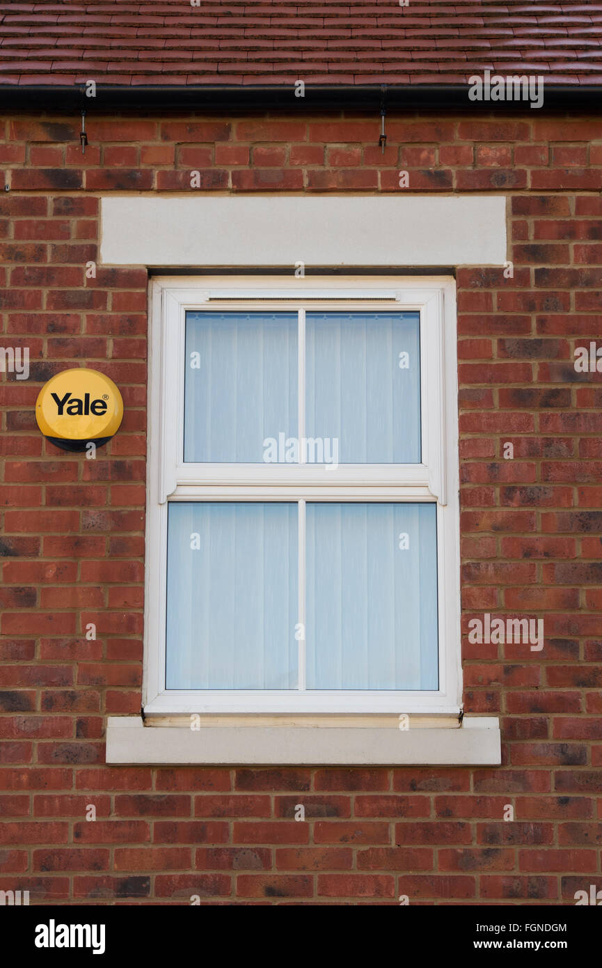 Yale alarm and window on a new house build. Bicester, Oxfordshire, England Stock Photo