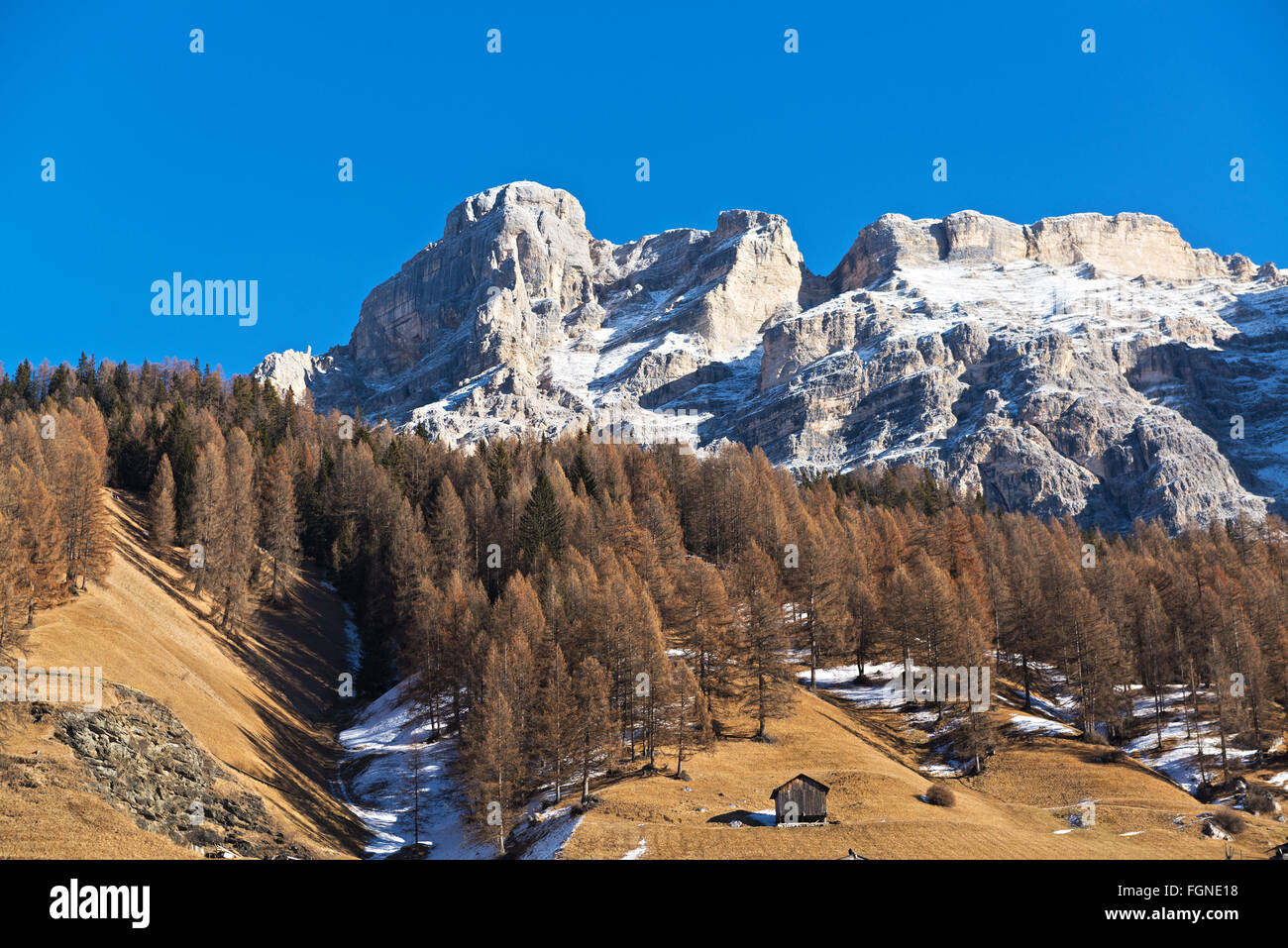 Mountains and hill landscape in autumn season with blue sky in background, Alta Badia - Dolomiti, Trentino-Alto - Stock Image