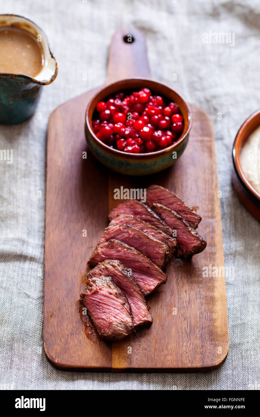 Venison, chestnut puree and lingonberries - Stock Image