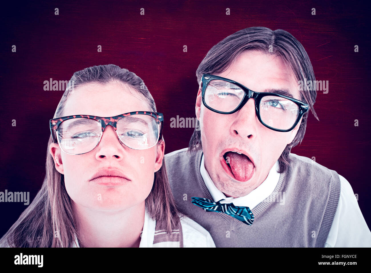 Composite image of funny geeky hipsters grimacing Stock Photo