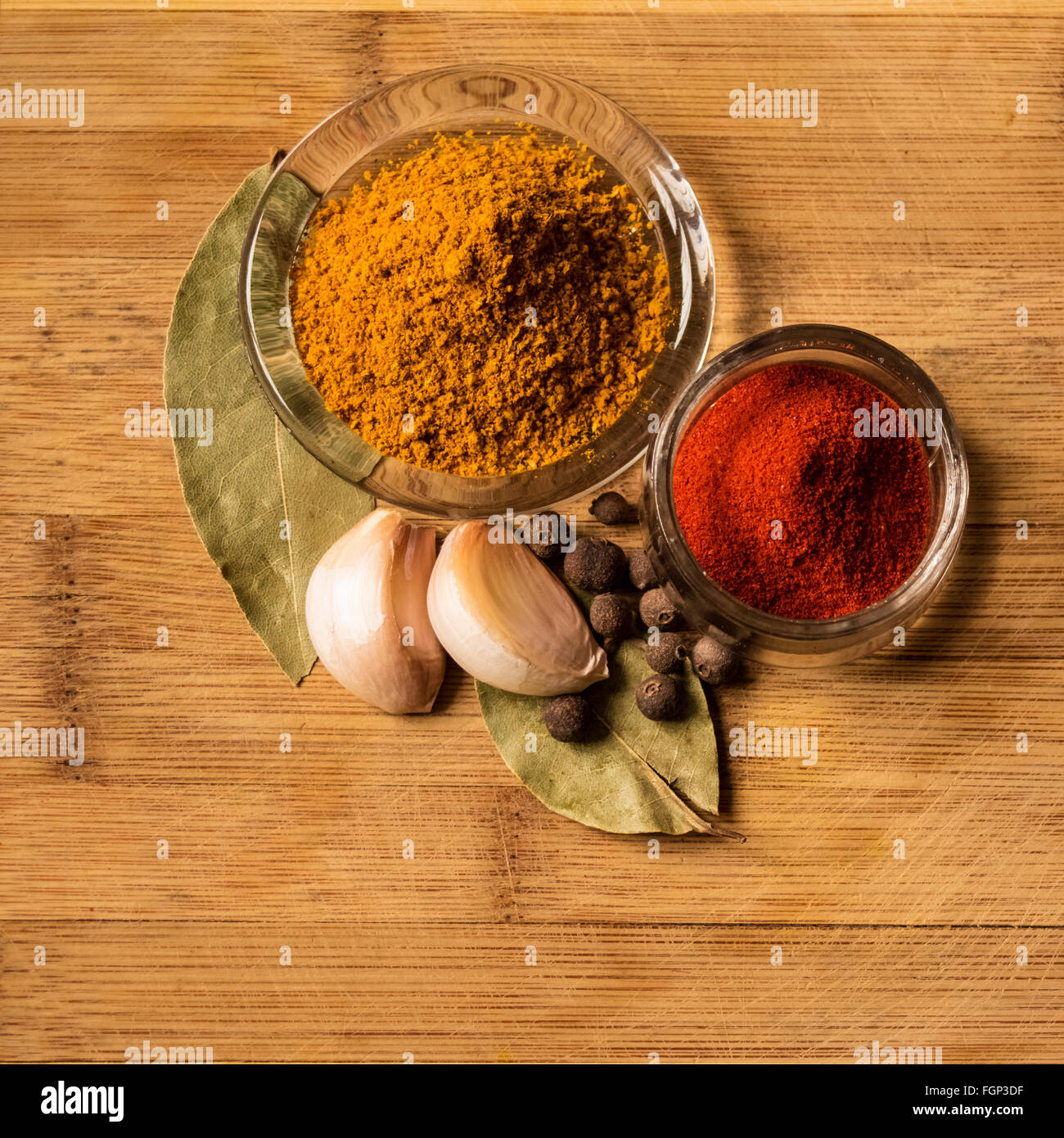 Spices on wooden background - Stock Image