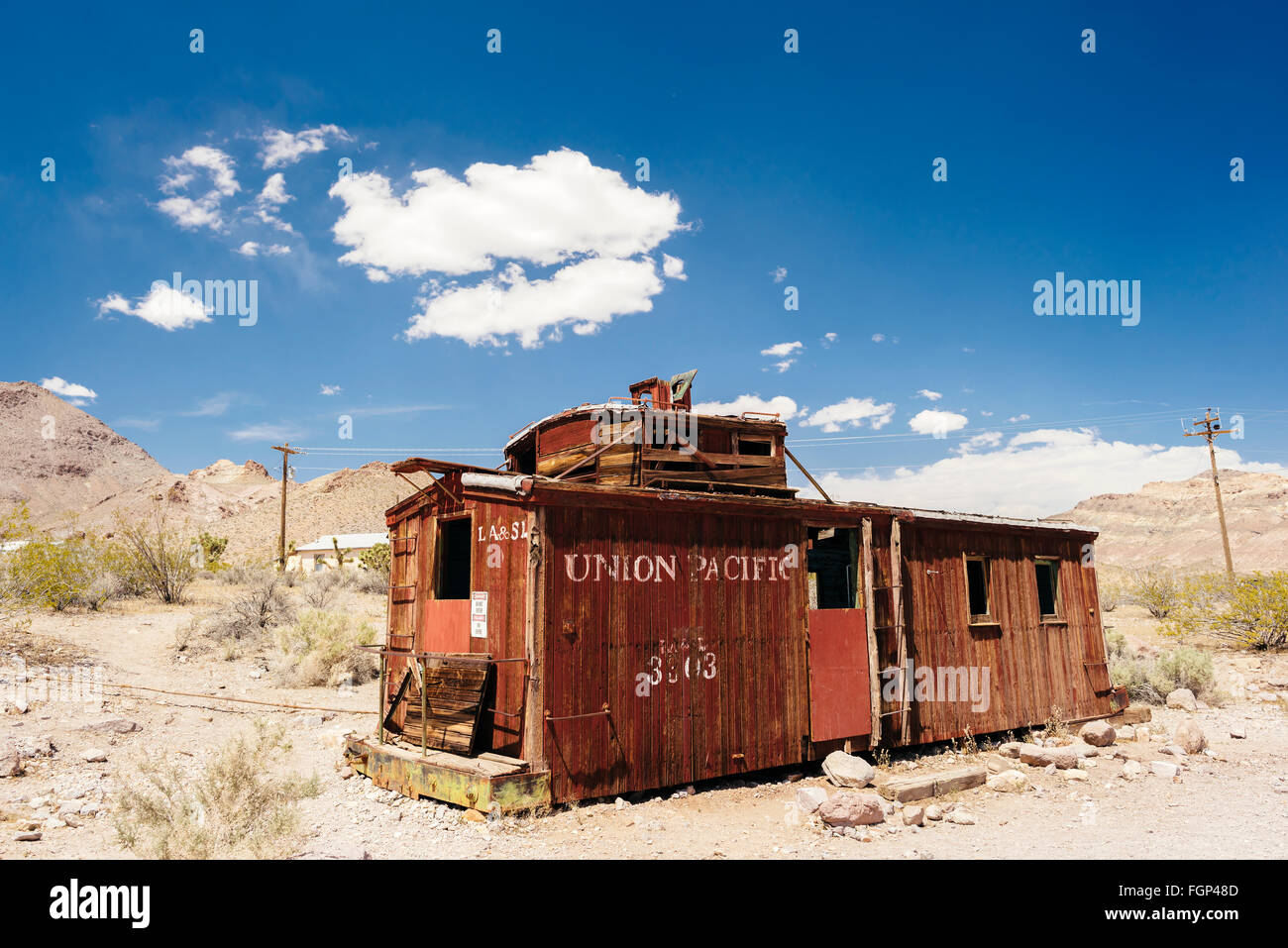 An abandoned railroad car in the desert ghost town of Rhyolite, Nevada - Stock Image