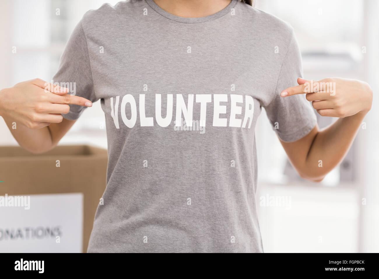 Female volunteer showing her shirt - Stock Image