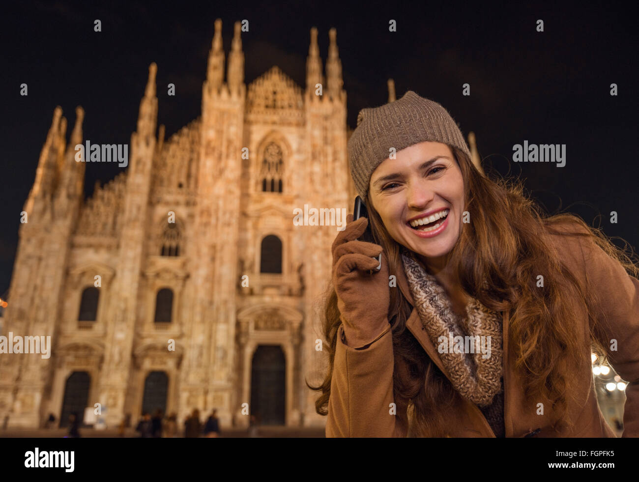 It is time to dress up and take a night tour in ultra-luxurious fashion expert - Milan, Italy. Portrait of smiling - Stock Image