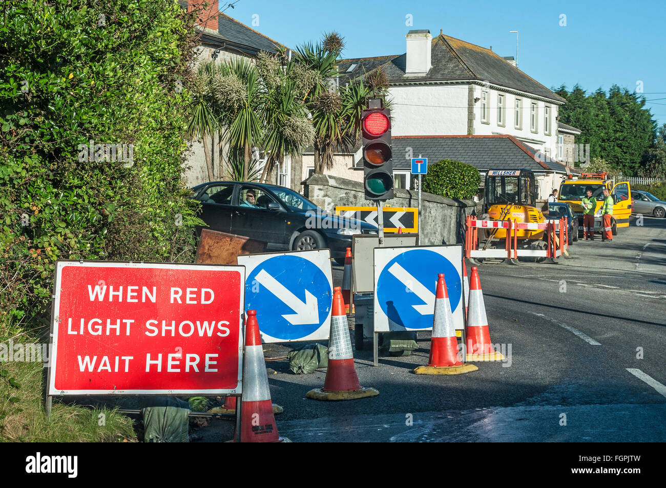Temporary traffic lights at roadworks, uk - Stock Image