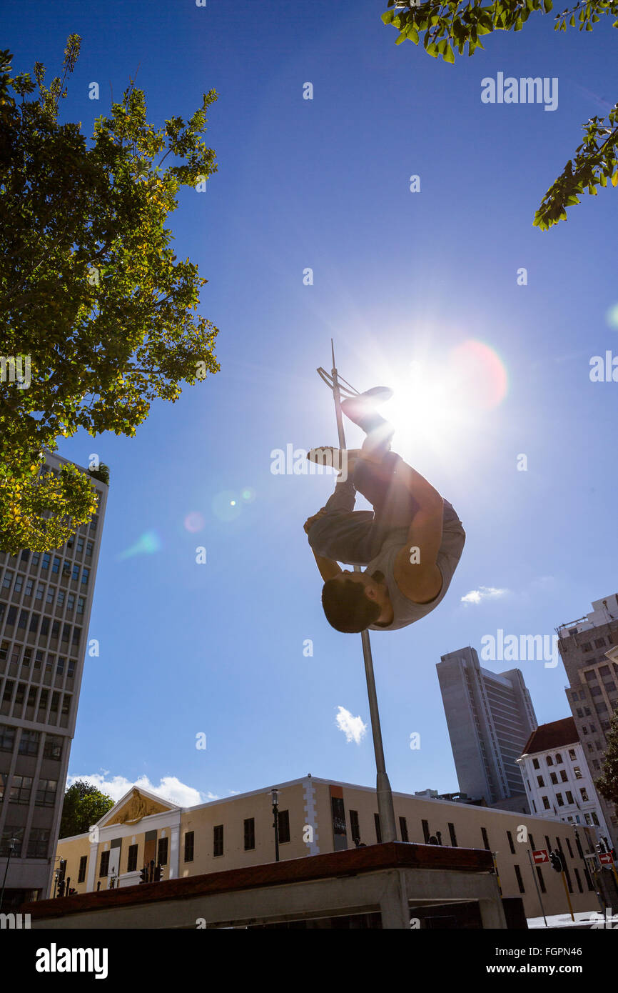 Man doing parkour in the city - Stock Image