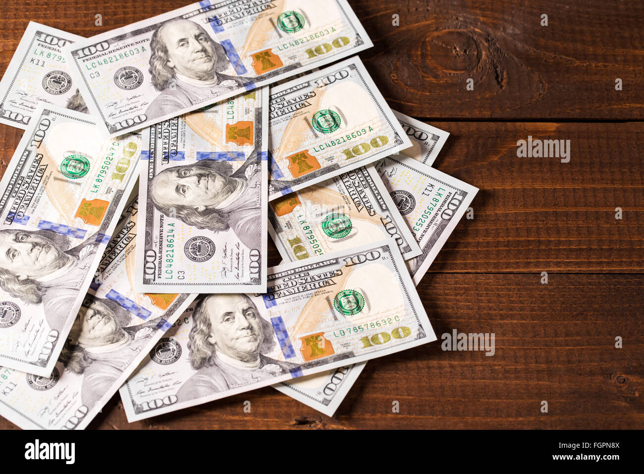 background of new 100 us dollars banknotes bills stock new 100 us dollars bills on wooden background stock photo 997
