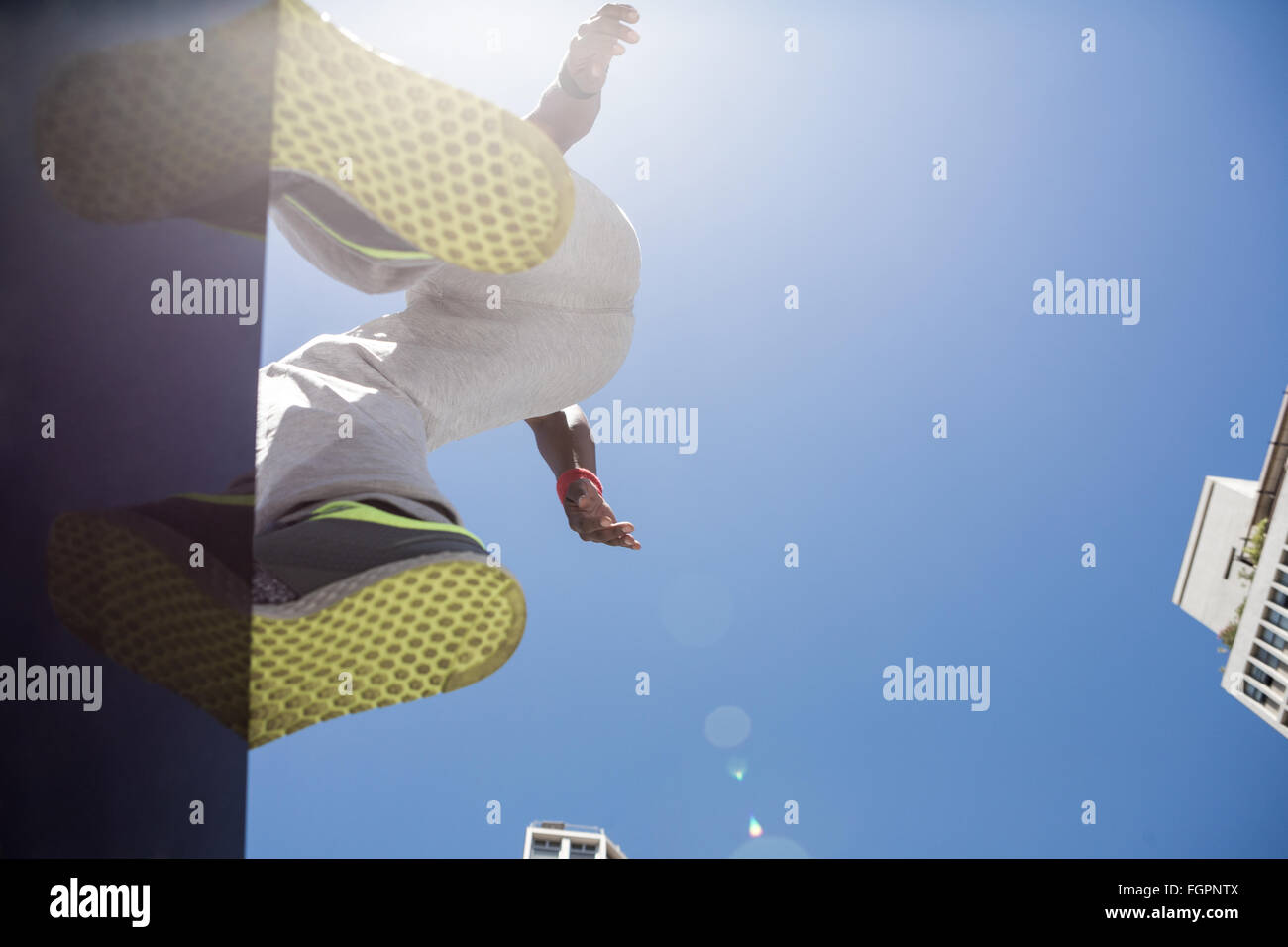 Athletic man about to do a back flip - Stock Image
