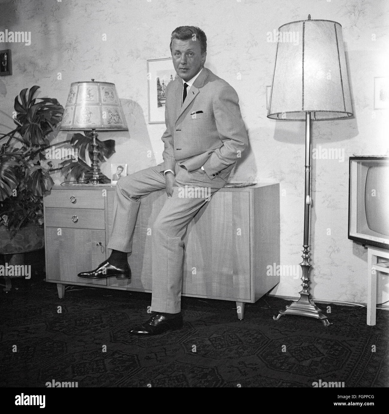 Furnishings Living Room Man Sitting On Commode 1950s Stock Photo