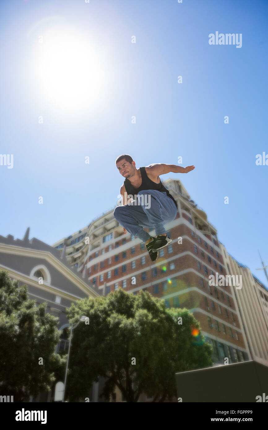 Athletic man doing parkour in the city - Stock Image