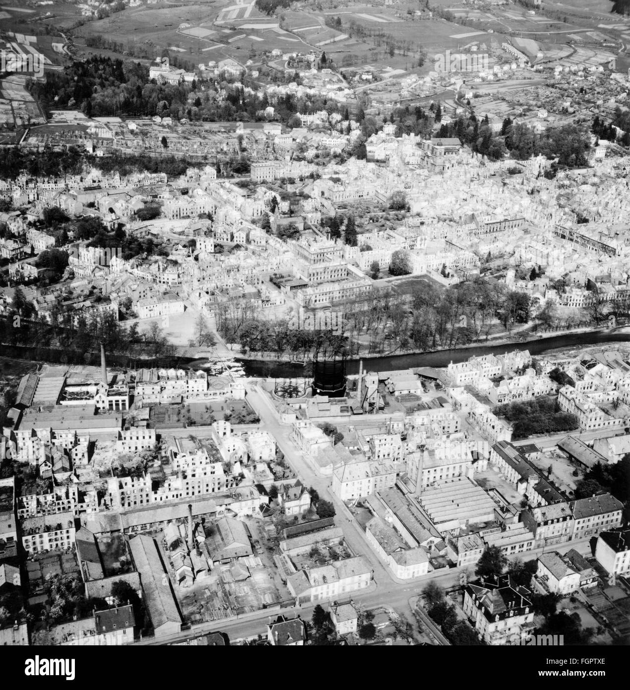postwar period, destroyed towns/cities, France, Saint-Die-des-Vosges, aerial view of the destroyed town with river - Stock Image
