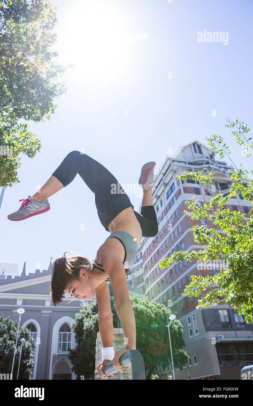 Woman doing parkour in the city - Stock Image