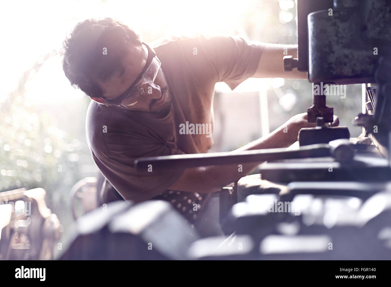 Blacksmith using vise grip in forge - Stock Image