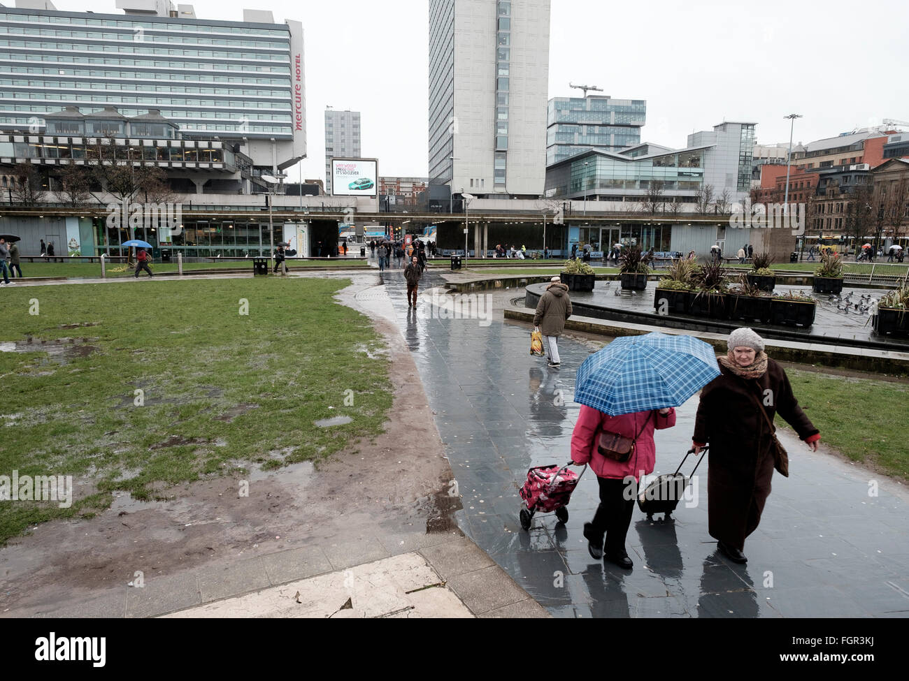 Manchester, UK - 17 February 2016: Raining on Piccadilly Gardens - Stock Image