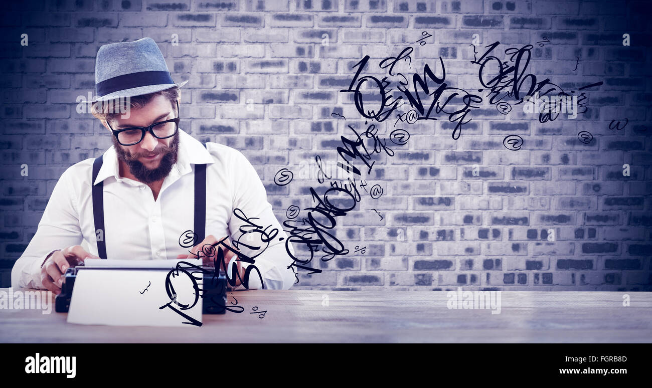Composite image of hipster wearing eye glasses and hat working on typewriter - Stock Image