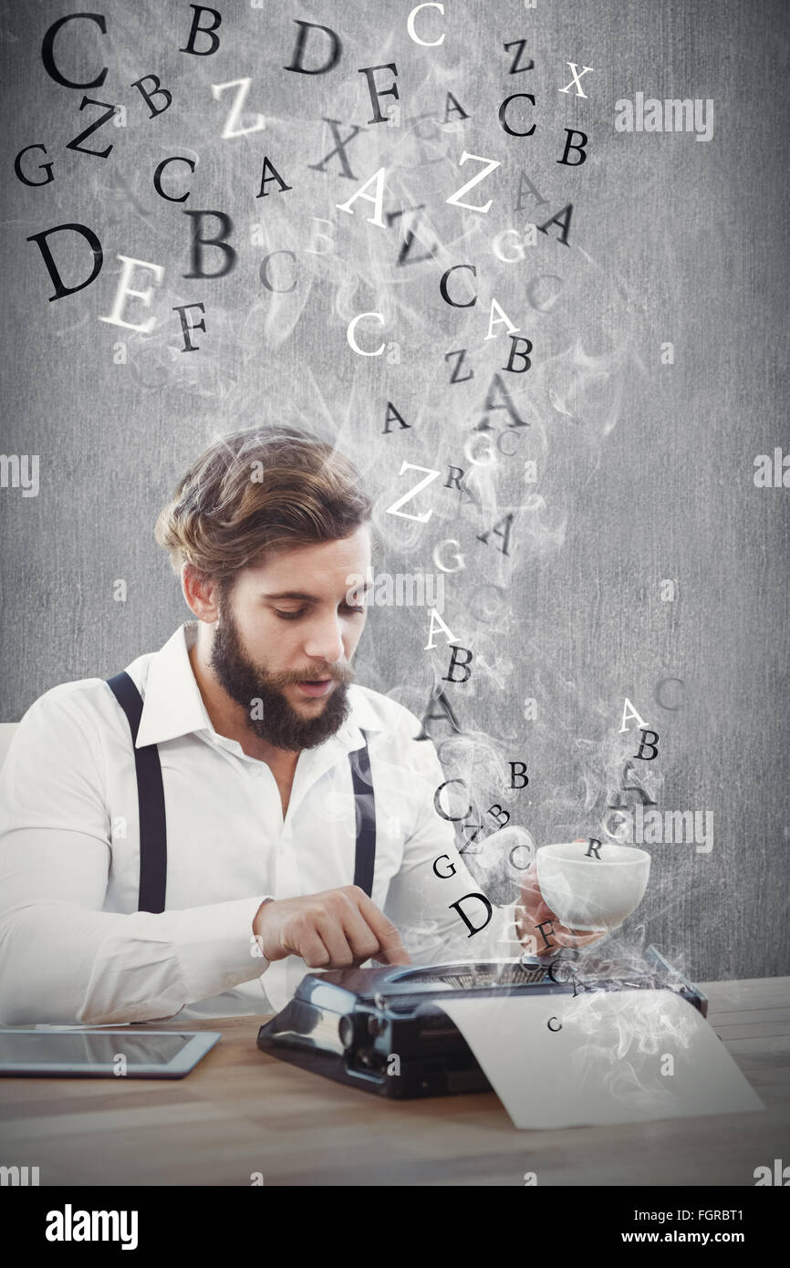 Composite image of hipster holding coffee working on typewriter - Stock Image