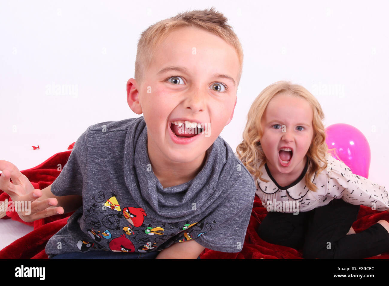 angry kids, shouting, aggressive behaviour, attention deficit hyperactivity disorder - Stock Image
