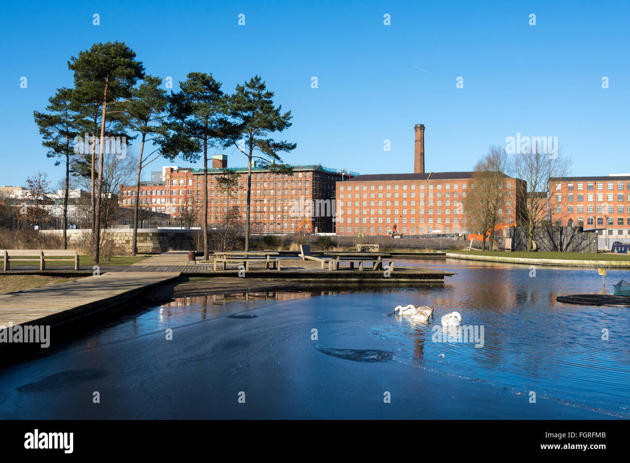 Former cotton mills, now apartments, from the Cotton Field Park marina, New Islington, Ancoats, Manchester, England, - Stock Image