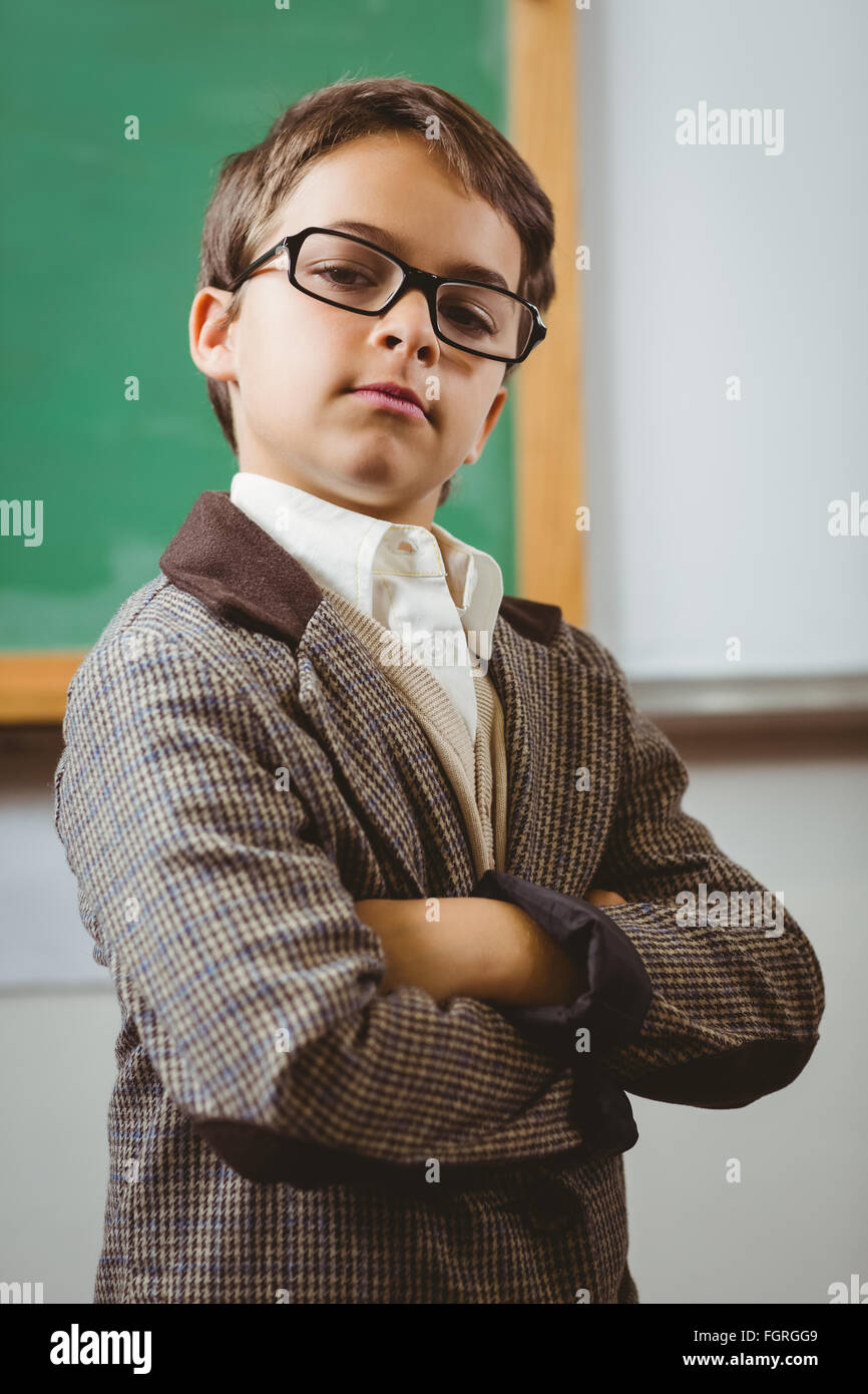 Pupil dressed up as teacher with arms crossed - Stock Image