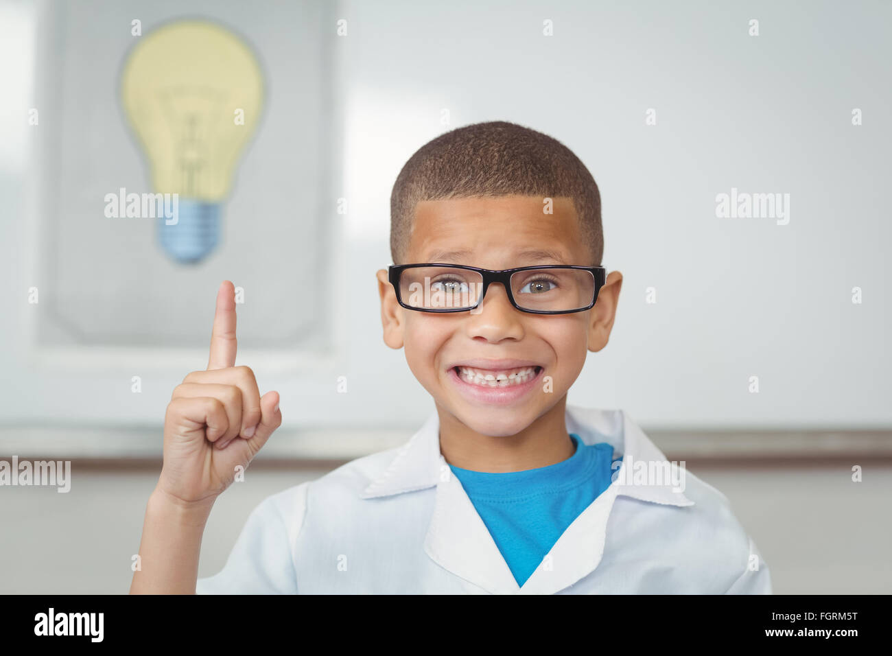 Smiling pupil with lab coat having an idea - Stock Image