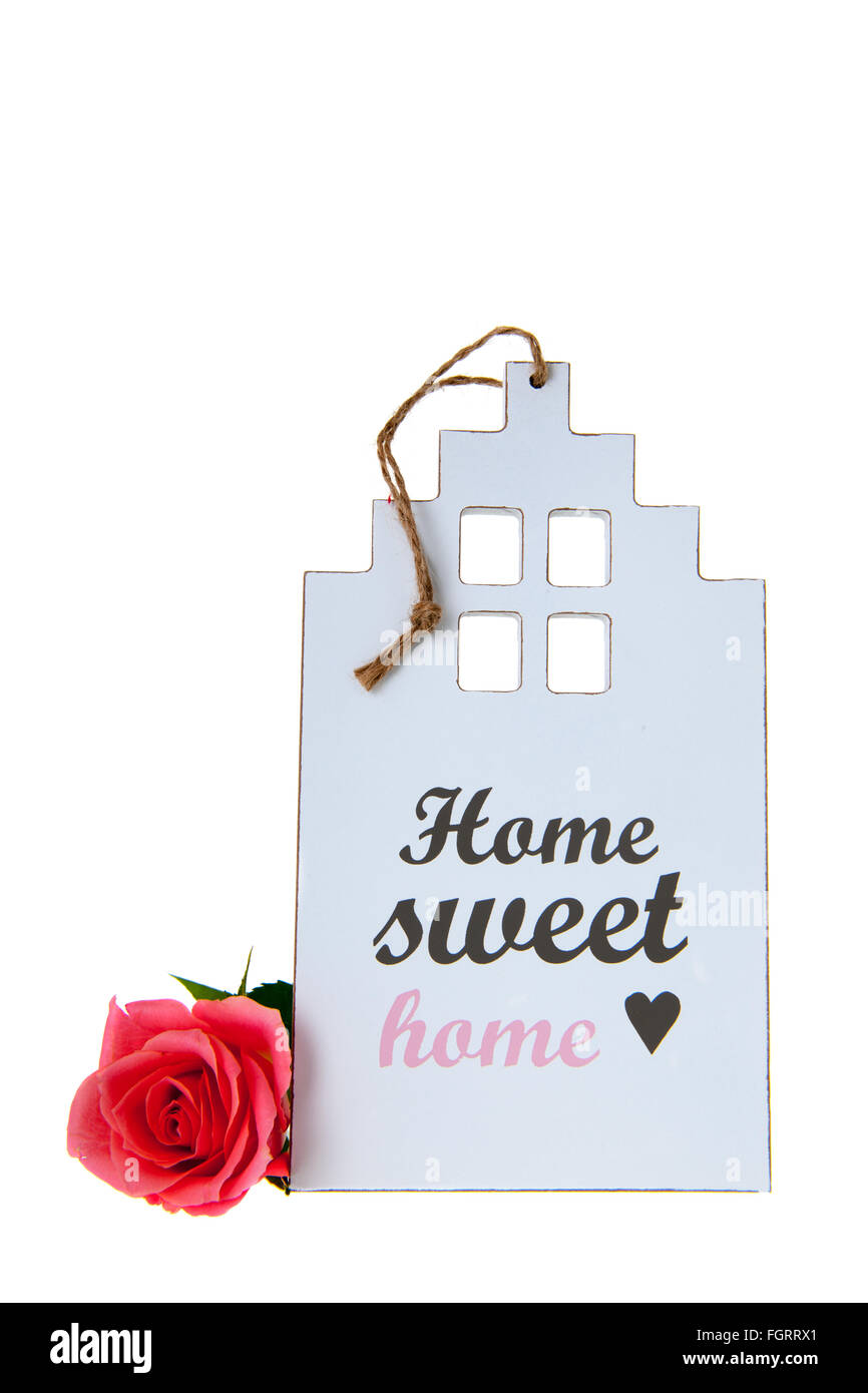 White miniature house with rose and home sweet home - Stock Image