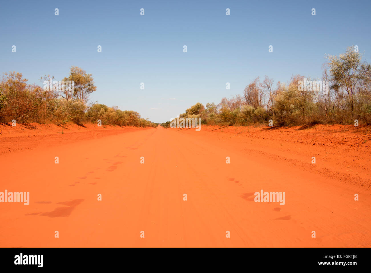 A wide outback vehicle sandy dirt track near Broome , a coastal, pearling and tourist town in the Kimberley region, - Stock Image