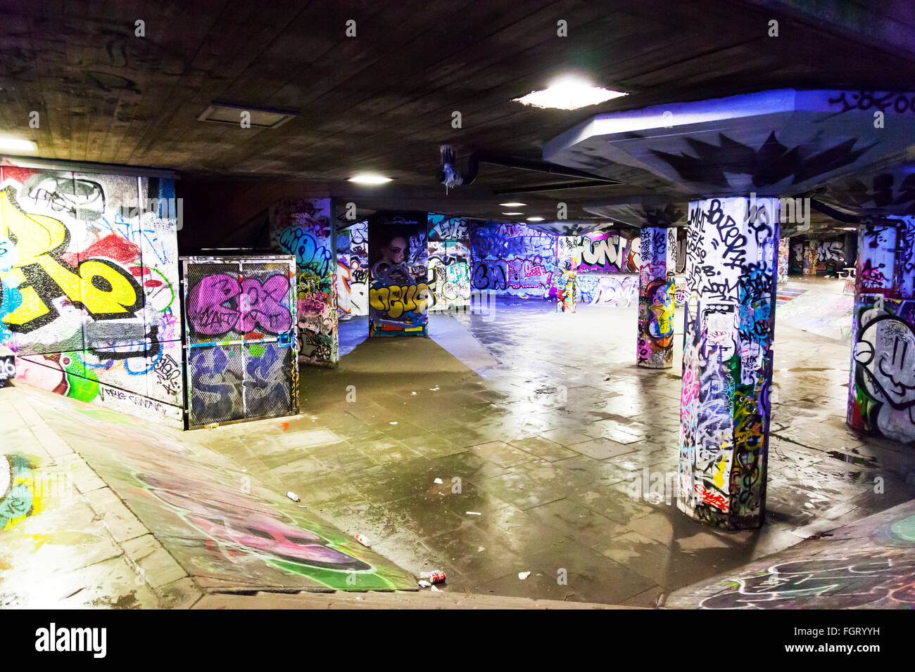 Graffiti London walls covered with spray paint art artistic design designs skate park pillars ramps - Stock Image