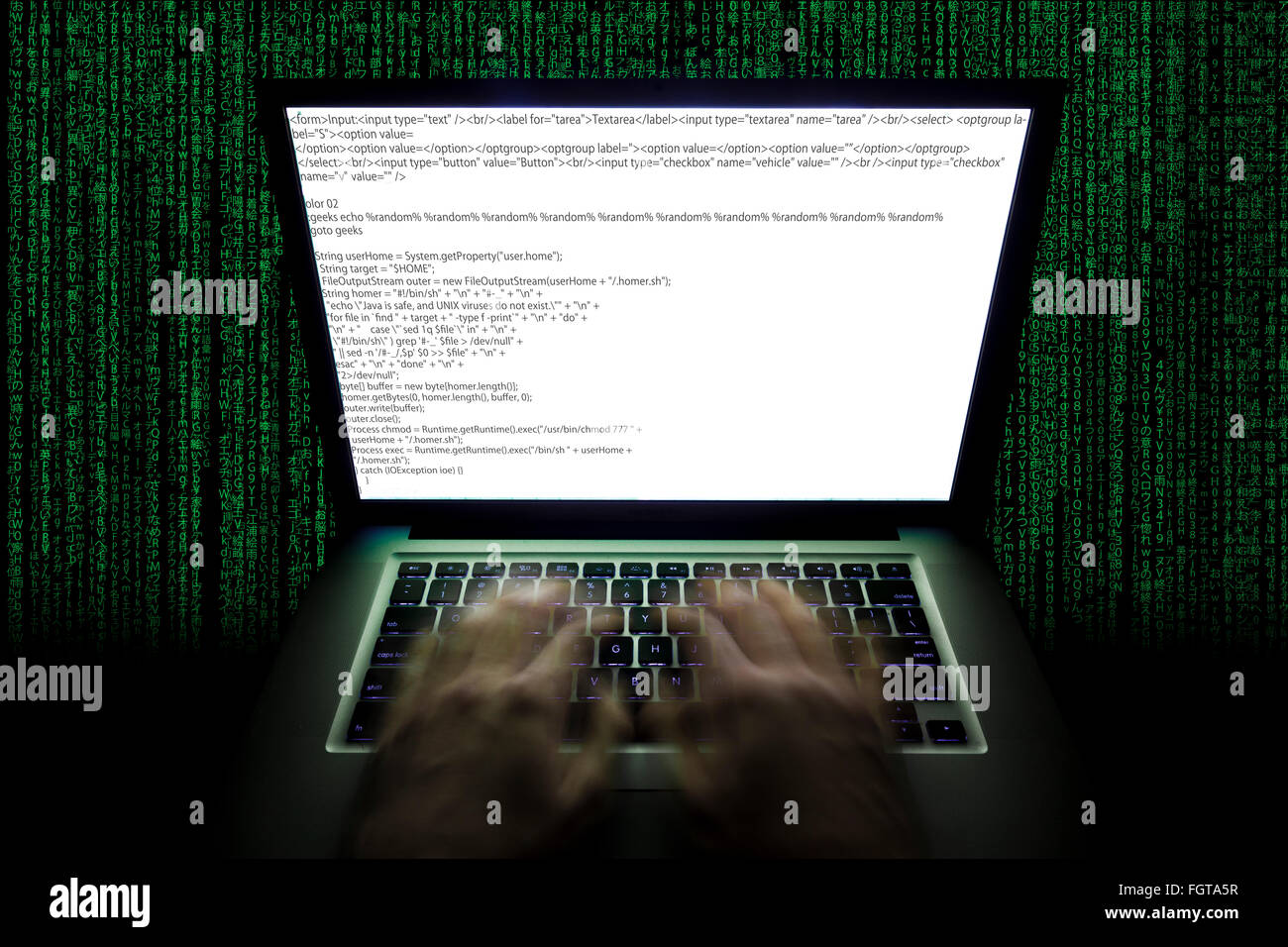 Moving hands at a laptop typing code - Stock Image
