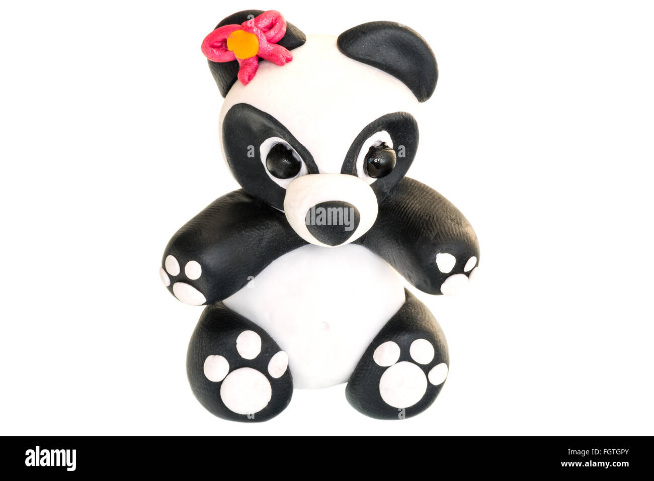 Panda figurine made of polymer clay on a white background. - Stock Image