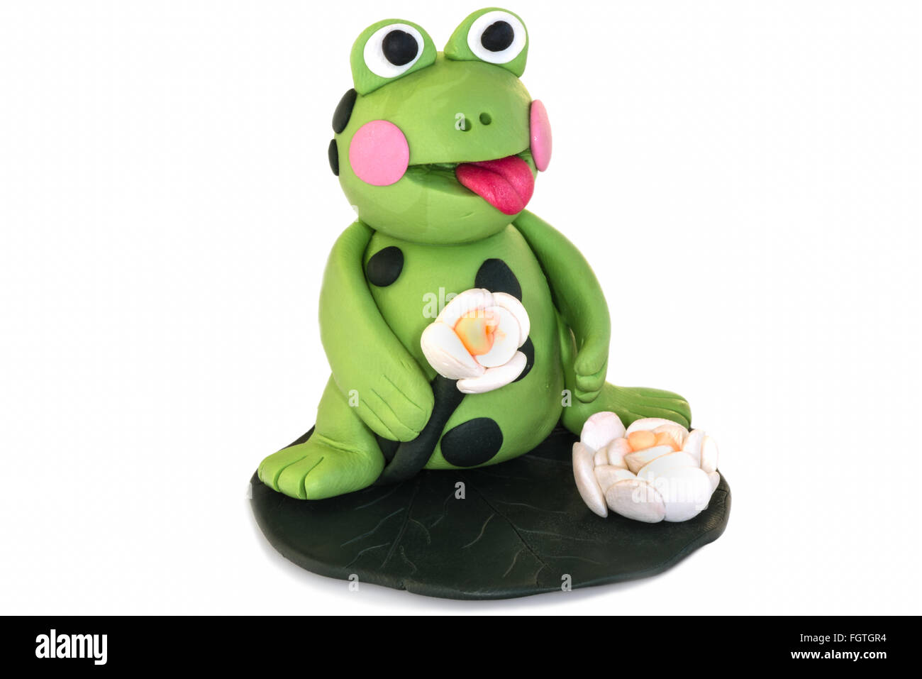 Frog figurine made of polymer clay on a white background . - Stock Image
