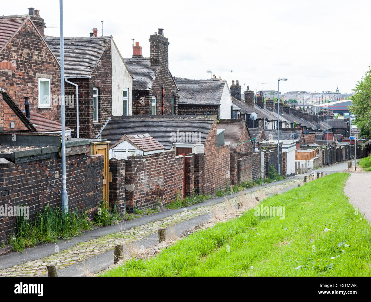 The backs at the rear of Terraced housing in Stoke on Trent Staffordshire England UK - Stock Image