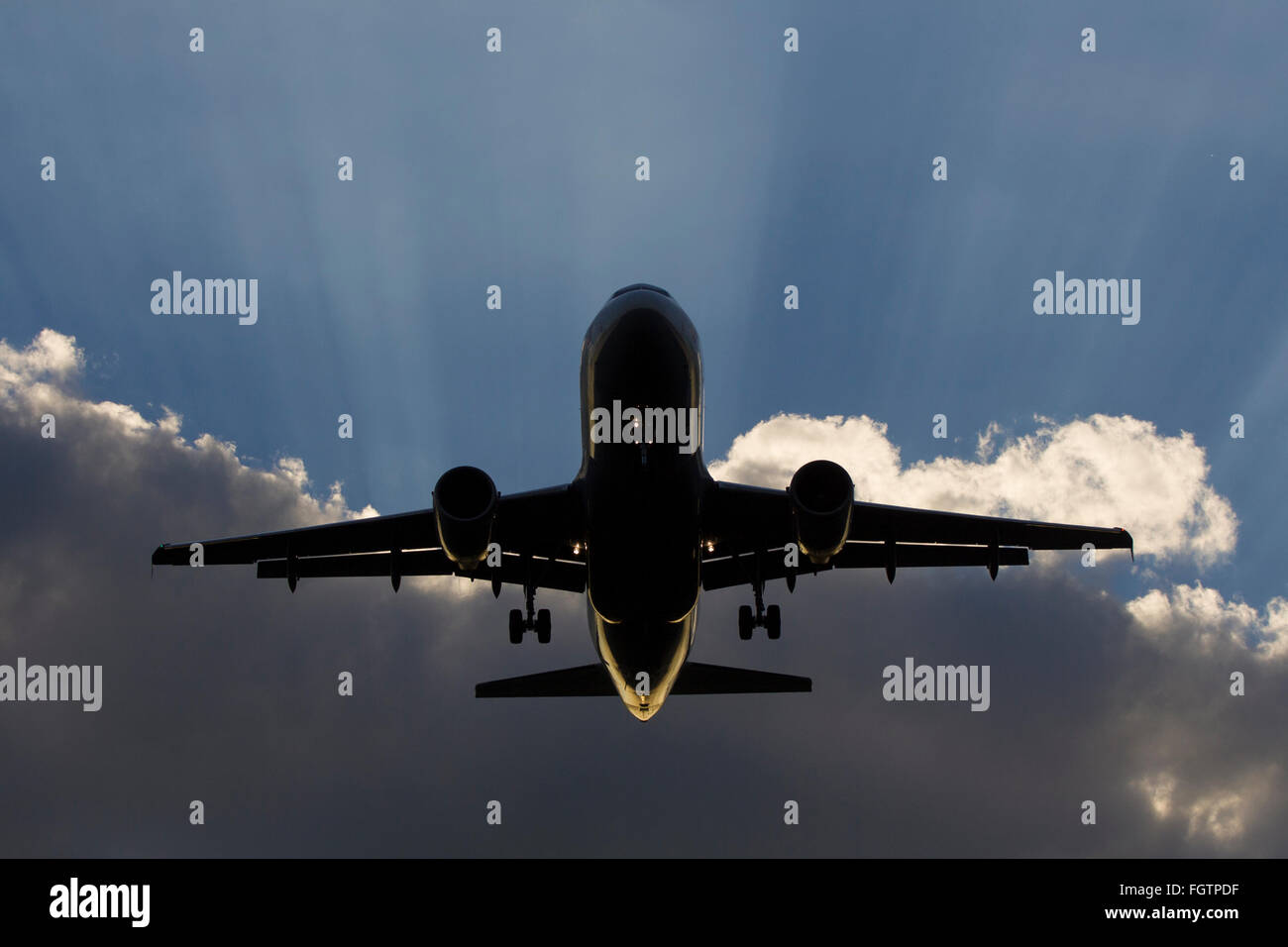 Airbus A320 landing at Heathrow with dramatic light effects in the