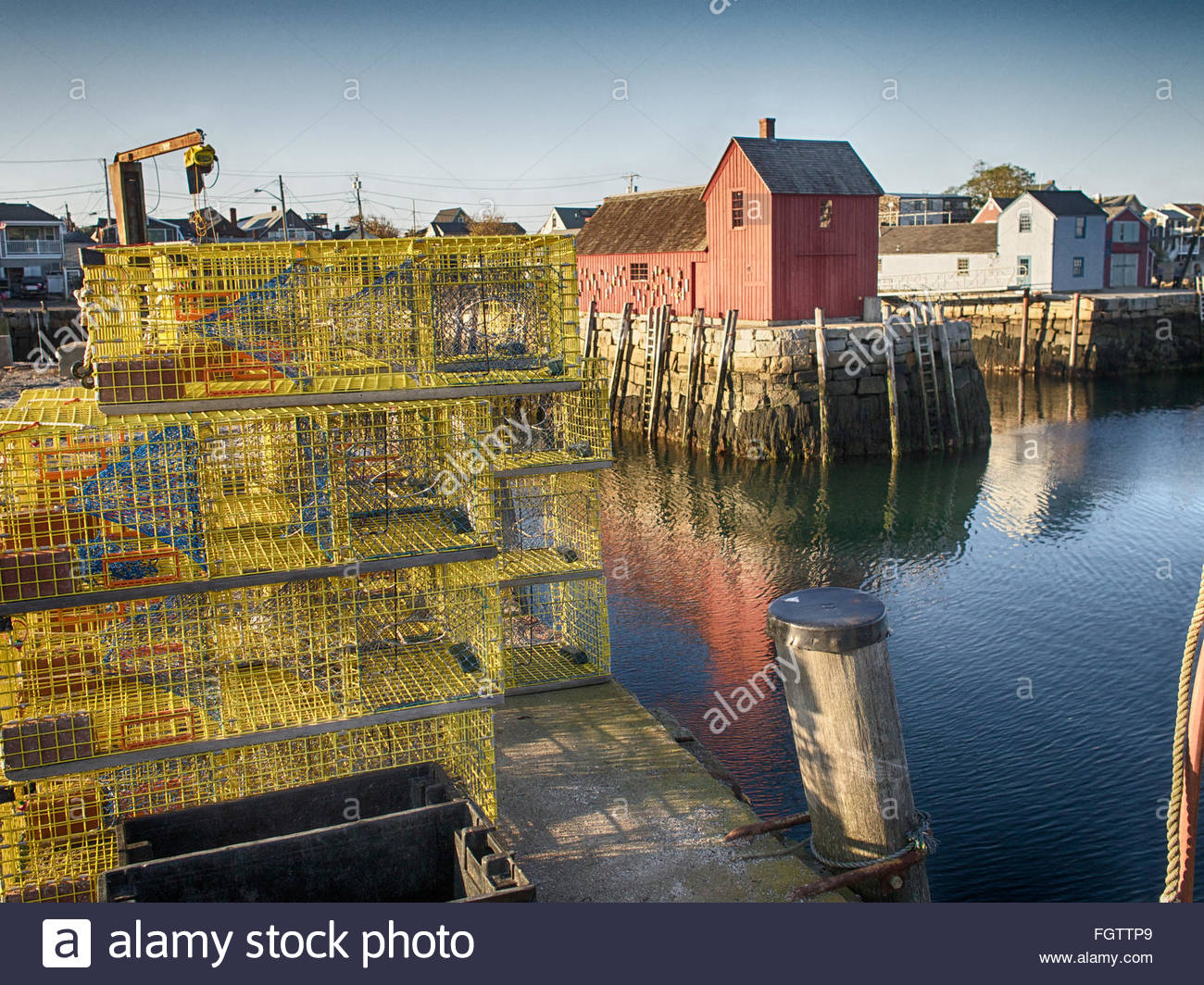 Lobster traps stacked near Motif Number 1 at Bradley Wharf in Rockport, Mass. - Stock Image